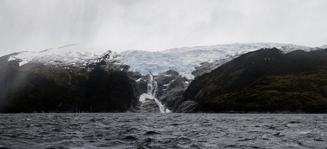 A glacier proceeds on its slow journey down the mountain to the water. Copyright Alexander Lindsay
