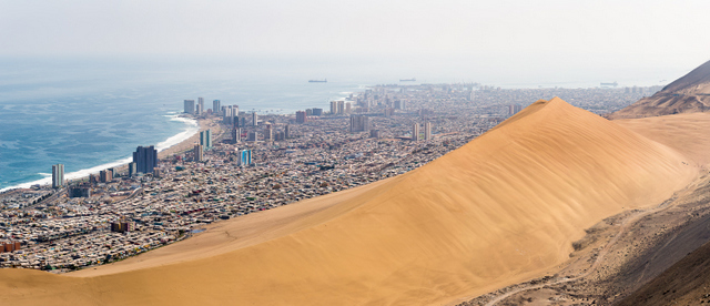 The Chilean city of Iquique is bordered on one side by the ocean and the other by a massive sand dune known as Dragon's Hill. Copyright Alexander Lindsay