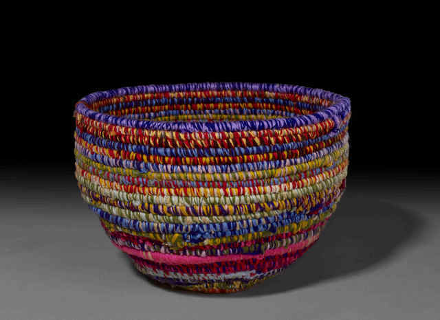 This basket is an example of modern weaving carried out by Aboriginal people today using the techniques of their ancestors. Reproduced by permission of the artist and Martumili artists