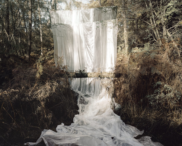This cascade, by Noemie Goudal, using sheets in a forest is designed to mimic a waterfall. Courtesy Saatchi gallery.