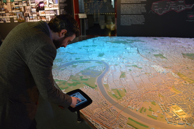 Touch-screen panels provide more info about buildings, and control spotlights to illuminate the map.