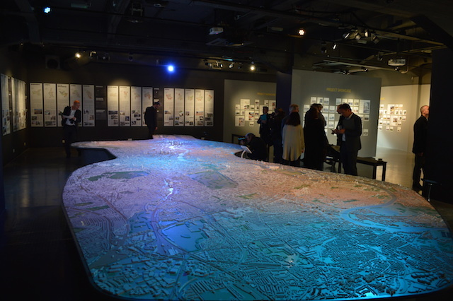 The super-sized map, bathed in azure lighting.