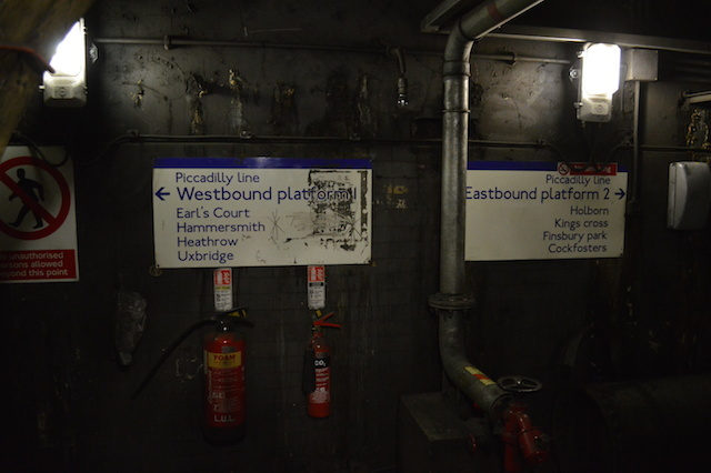 These signs are clearly installed in recent years. They were never intended for passenger use, but help contractors find their way.