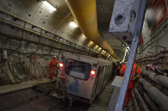 The rail lines move workers and materials along the 4.3 mile tunnel.
