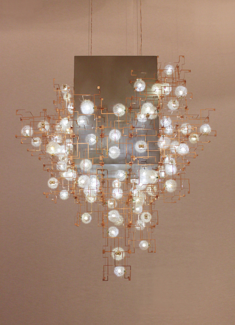 This remarkably fragile and impractical chandelier features dandelion seed heads in its design. © Studio Drift, Courtesy of Carpenters Workshop Gallery