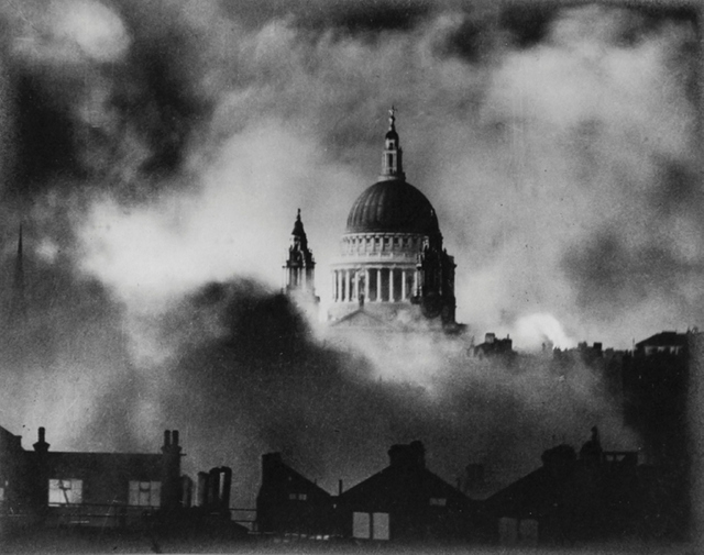 St. Paul's seems to float as it survives a bombing raid during the Blitz in 1940. Photo: Herbert Mason.
