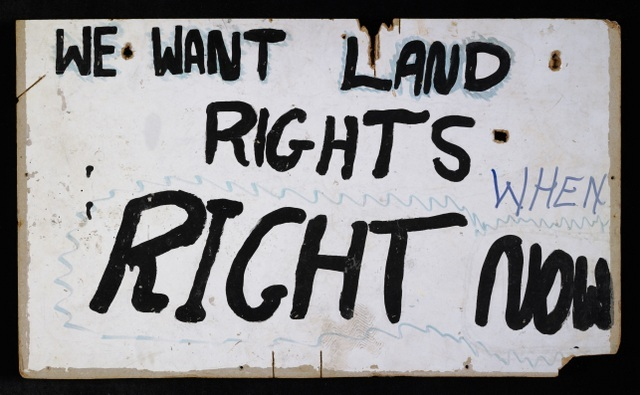 The treatment of Aborigines is tackled head on. An example is this protest banner from 1972. National Museum of Australia