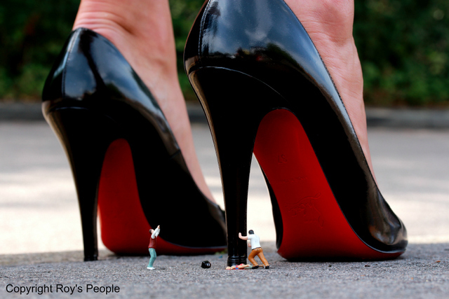 Literal killer heels squash a tiny person.