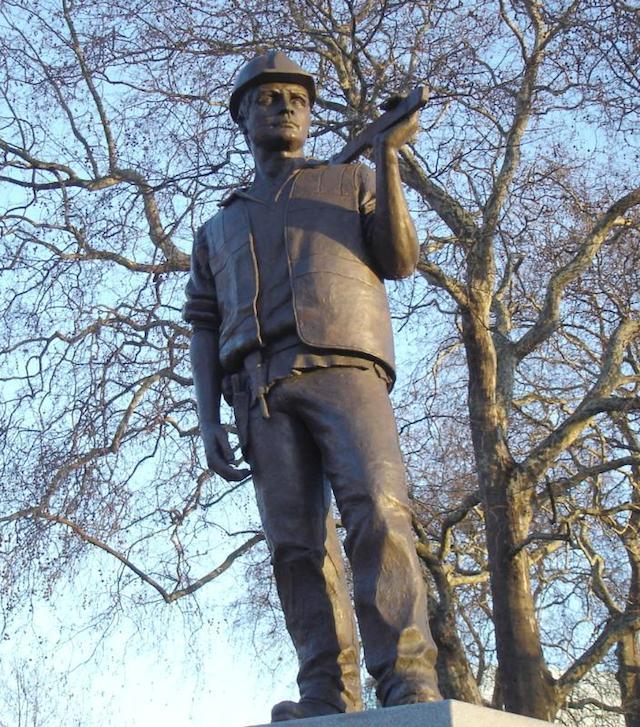 Alan Wilson's building worker statue commemorates all those who work in the construction industry, and particularly those who lost their lives during such work. It's just north of the Tower of London.