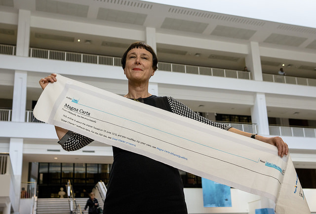 Cornelia Parker with a fragment of Magna Carta (An Embroidery) at the British Library. Photo by Tony Antoniou