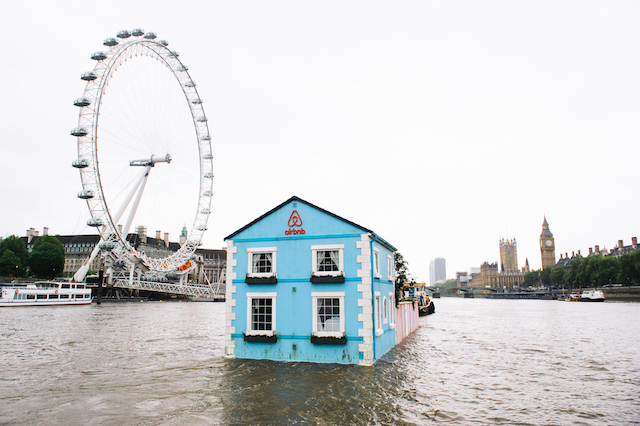 Monday 18th May 2015, London:  Airbnb's latest London listing is pictured floating down the River Thames this morning.  This pic: The house going past the London Eye   The fully functioning Floating House will sail down the Thames to celebrate new rules that mean that Londoners – like the rest of the UK – can earn a 15 per cent pay rise* by sharing their homes through sites like Airbnb. Passing under Tower Bridge before gliding past the Shard on its maiden voyage, the House will meander along the river throughout the week until Saturday 22 May.  Copyright: © Mikael Buck / Airbnb +44 (0) 782 820 1042 http://www.mikaelbuck.com