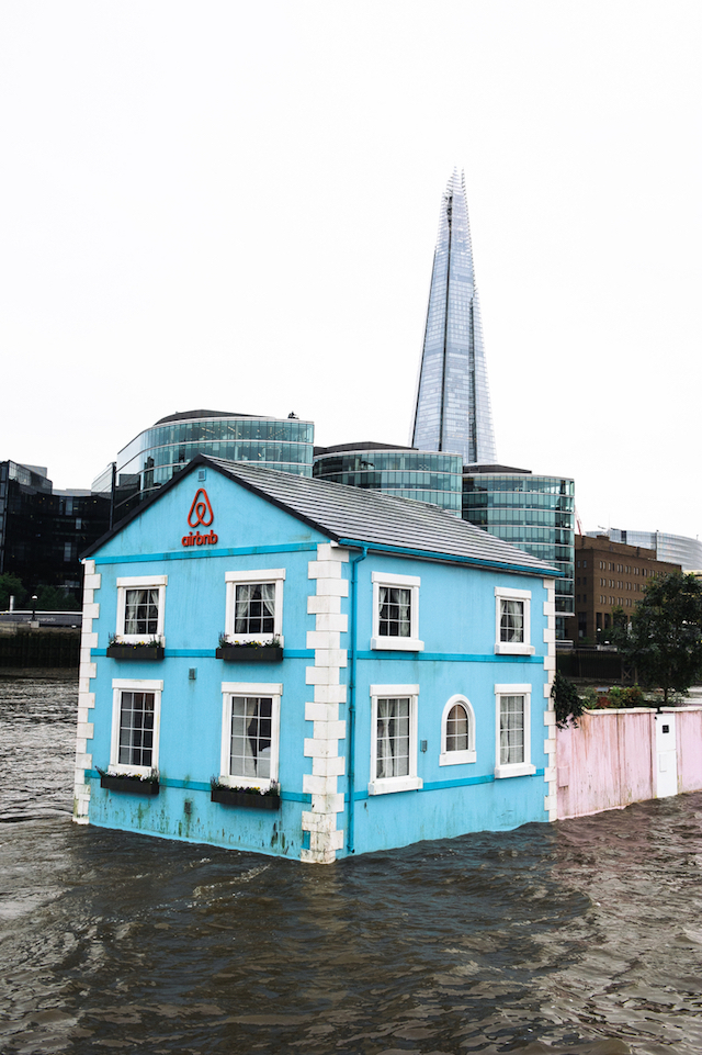 Monday 18th May 2015, London:  Airbnb's latest London listing is pictured floating down the River Thames this morning.  This pic: The house on the Thames going past the Shard   The fully functioning Floating House will sail down the Thames to celebrate new rules that mean that Londoners – like the rest of the UK – can earn a 15 per cent pay rise* by sharing their homes through sites like Airbnb. Passing under Tower Bridge before gliding past the Shard on its maiden voyage, the House will meander along the river throughout the week until Saturday 22 May.  Copyright: © Mikael Buck / Airbnb +44 (0) 782 820 1042 http://www.mikaelbuck.com