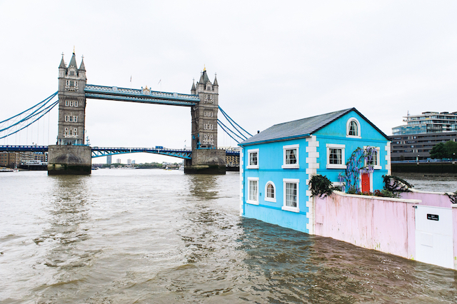 Monday 18th May 2015, London:  Airbnb's latest London listing is pictured floating down the River Thames this morning.  This pic: The house with Tower Bridge in the background  The fully functioning Floating House will sail down the Thames to celebrate new rules that mean that Londoners – like the rest of the UK – can earn a 15 per cent pay rise* by sharing their homes through sites like Airbnb. Passing under Tower Bridge before gliding past the Shard on its maiden voyage, the House will meander along the river throughout the week until Saturday 22 May.  Copyright: © Mikael Buck / Airbnb +44 (0) 782 820 1042 http://www.mikaelbuck.com