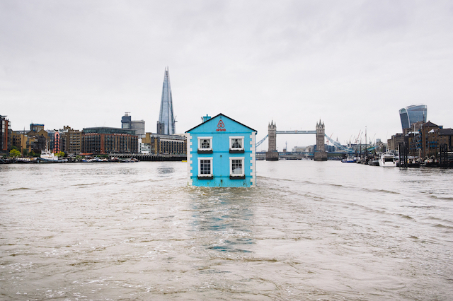 Monday 18th May 2015, London:  Airbnb's latest London listing is pictured floating down the River Thames this morning.  This pic: The house on the Thames with the Shard and Tower Bridge in the distance   The fully functioning Floating House will sail down the Thames to celebrate new rules that mean that Londoners – like the rest of the UK – can earn a 15 per cent pay rise* by sharing their homes through sites like Airbnb. Passing under Tower Bridge before gliding past the Shard on its maiden voyage, the House will meander along the river throughout the week until Saturday 22 May.  Copyright: © Mikael Buck / Airbnb +44 (0) 782 820 1042 http://www.mikaelbuck.com