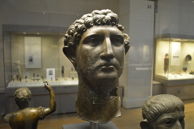 You're looking at a statue that could well have been as famous as Nelson's Column or 'Eros' to the citizens of Roman London. It depicts Emperor Hadrian (or possibly Alfred Molina). The bronze head was part of a larger statue, and is displayed alongside a thumbless hand possibly from the same sculpture. See it: Room 49, Roman London.