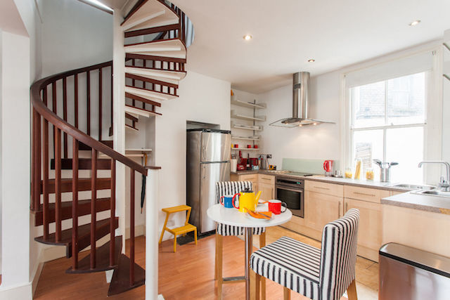 Spiral staircase and kitchen in Greenwich.