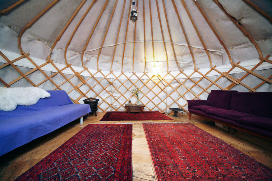 This huge Highgate yurt is furnished with genuine Persian rugs.