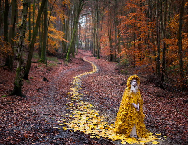 There's something of a sad procession to this image, despite the bright colours. Copyright Kirsty Mitchell