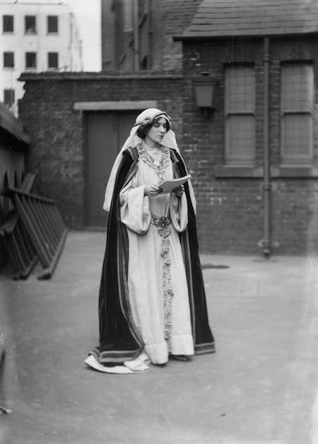 A Suffragette in costume at the Green, White and Gold fair, organised by the Women's Freedom League, 1909 © Museum of London