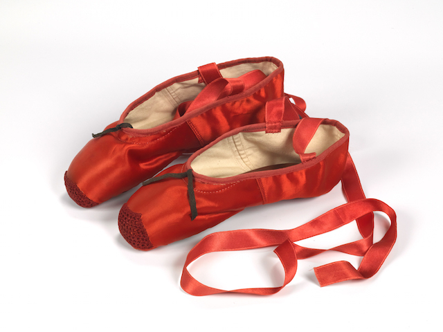 Freed of London founded in 1929, Red Ballet Shoes made for Victoria Page Moira, Shearer in the Red Shoes 1948. Silk, satin, braid and leather, England 1948, Northampton Museums and Art Gallery