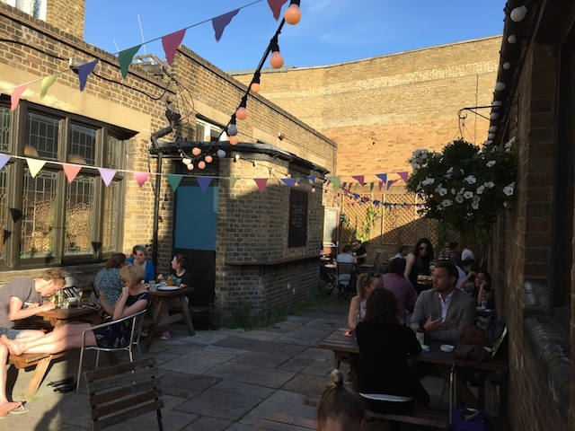 Small beer yard with bunting a-plenty.