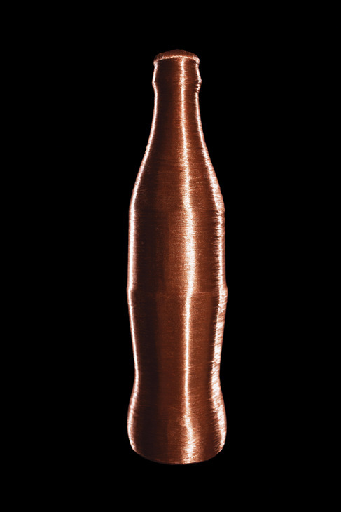 Some things may become unrecognisable when entombed in copper, but not so for the iconic bottle shape of this popular soft drink. Courtesy of the Artist