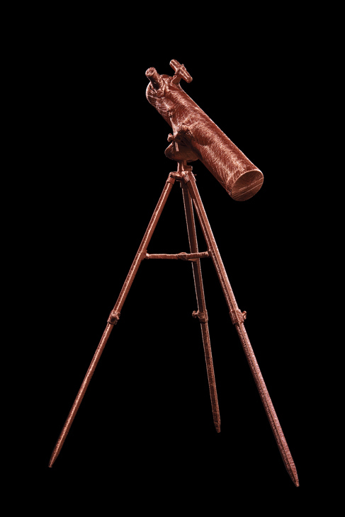 A telescope shines instead of the stars it would usually see. Photo © Matt Holyoak