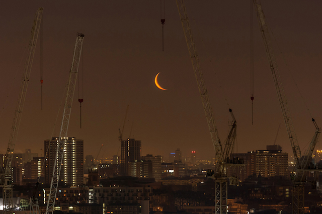 Cranes and crescent moon, April 2013. Purely because the moon looks like it's being lifted by the crane, this one has to make the collection.
