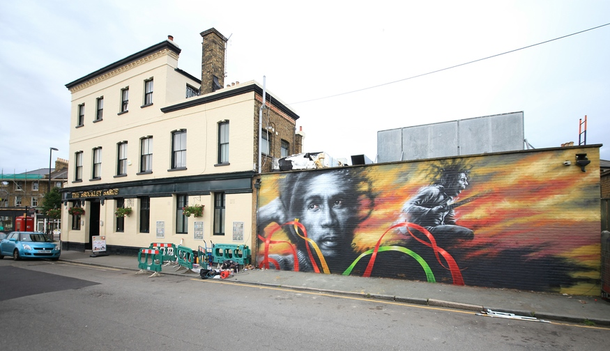 This was the flagship mural at the recent Brockley Street Art Festival. Artist Dale Grimshaw had broken his foot so was wearing a moonboot yet persevered to produce this amazing mural, replacing a Bob Marley mural that was lost in Brockley a few years ago having stood, in one form or another, for around 40 years prior. Photo by Nelly Balazs.