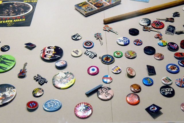 A selection of badges and pins associated with the band. Photo Mary Turner (Getty images for Somerset House)