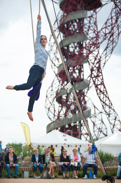 A trapeze artist performs at the Liberty Festival 2014