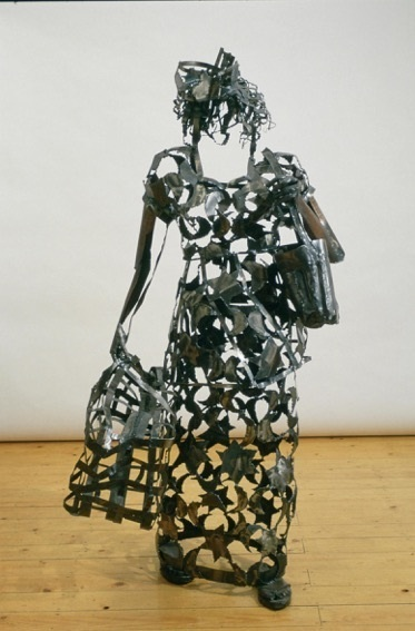 A sculpture of a Nigerian woman shopping.