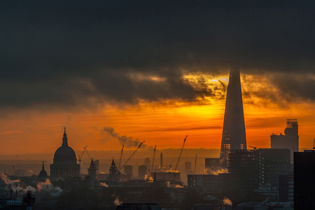 Sunrise by The Shard, December 2013. I love this moody image of the sun rising behind The Shard which was taken from Camden.