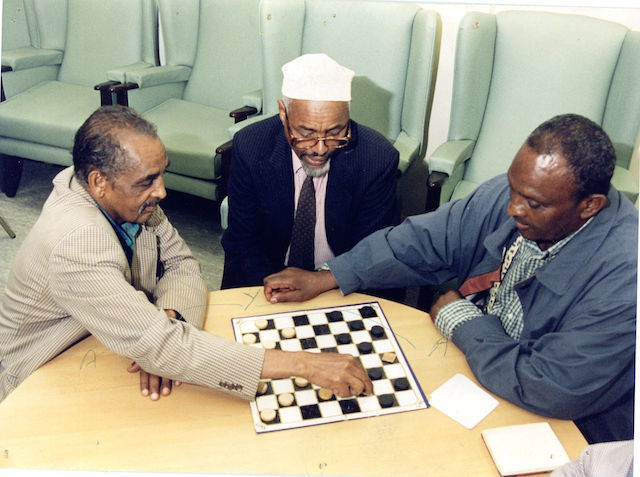 LB Tower Hamlets, Somali Day Centre users playing chess, early 1990s (© London Borough of Tower Hamlets)