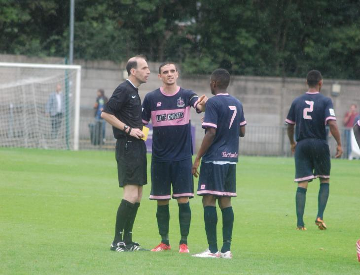 Dulwich Hamlet skipper Danny Waldren and midfielder Nyren Clunis remonstrate with referee John O'Brien.