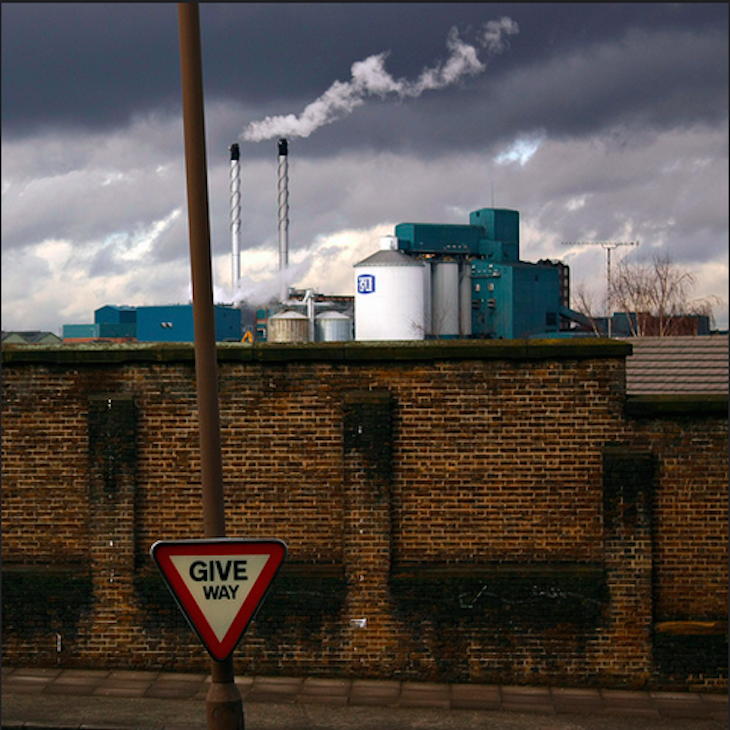 Old wall of the docks and beyond it the Royal Arsenal Factory originally known as the Woolwich Warren. Photo:  Aperture_Addict (2010)