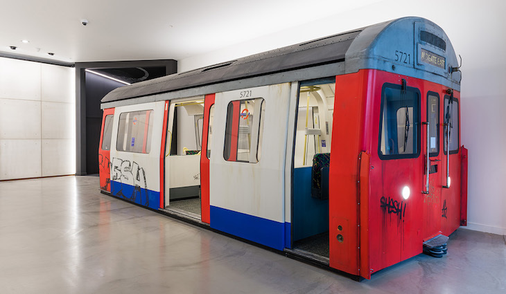 tube office. a peculiar piece of corporate art or has some driver taken very wrong turn tube office