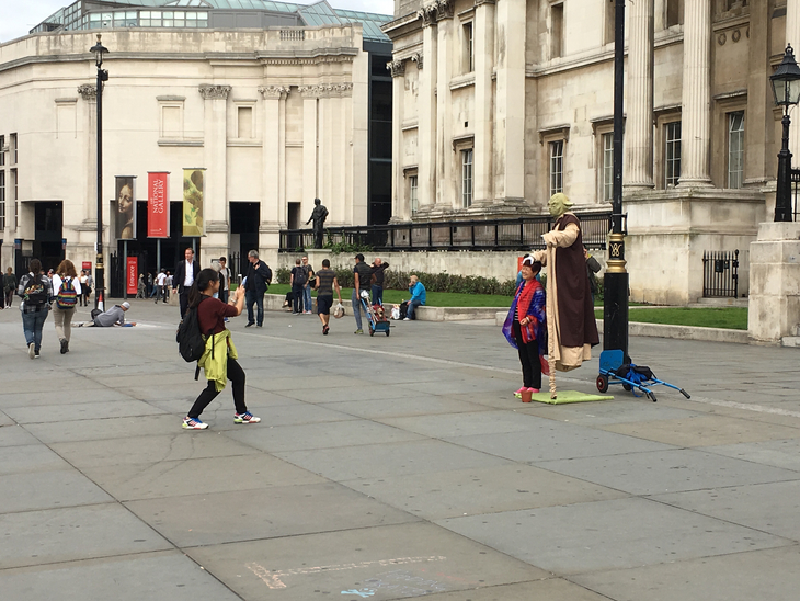 Who are the people dressed as levitating Yodas outside the National Gallery?