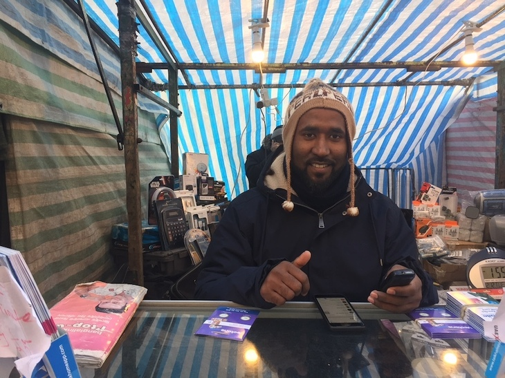 Mostafa Kamal at his stall in Whitechapel Market.