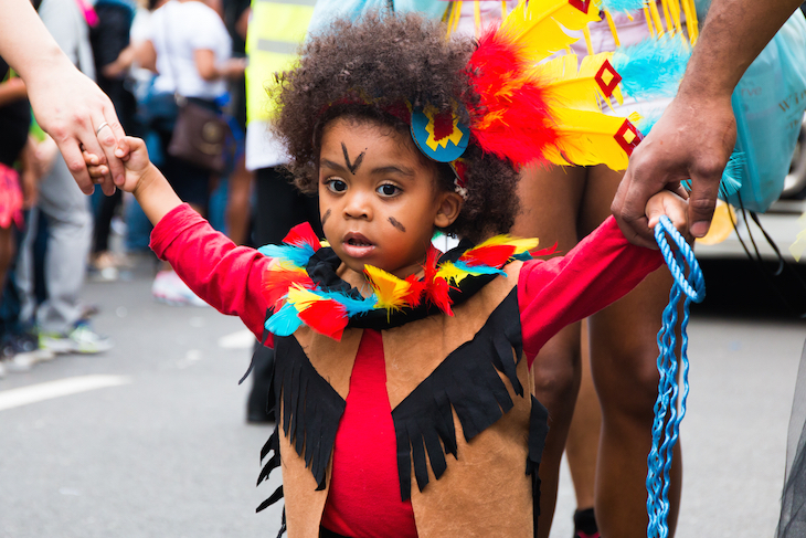 A child in fancy dress at Notting Hill Carnival.
