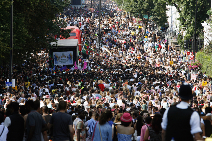 A street packed with people at Notting Hill Carnival in west London