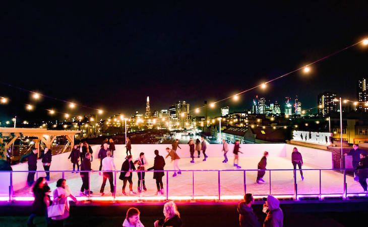 The Christmas ice skating rink on the roof at Skylight, Tobacco Dock, London: Where to go ice skating in London at Christmas