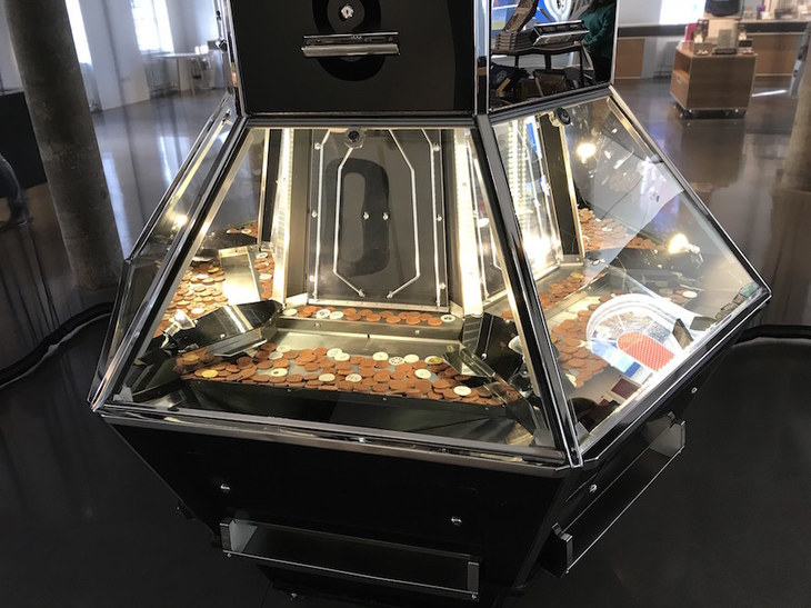A push penny machine as artwork.