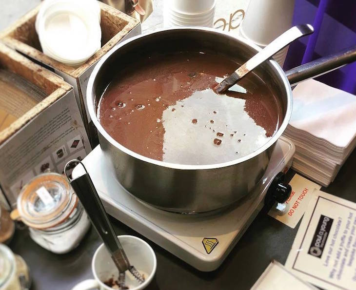 Pan of hot chocolate at Paul A Young chocolatier, one of the best hot chocolates in London