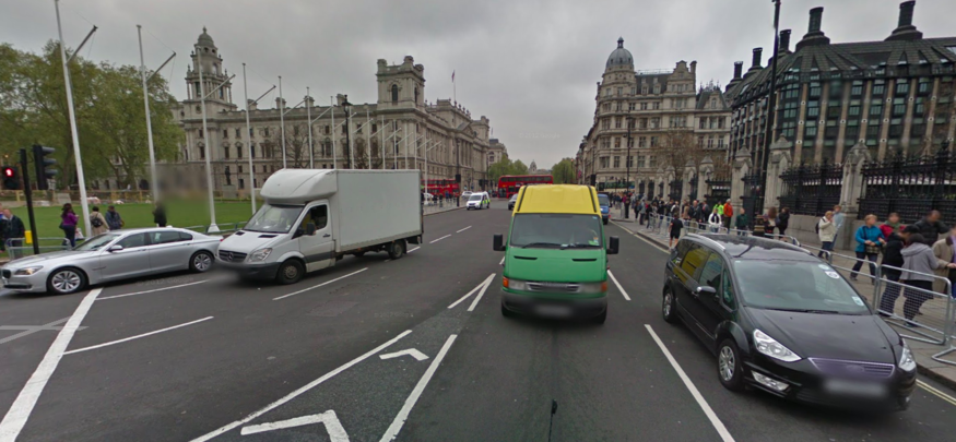 Five lanes of traffic outside houses of parliament