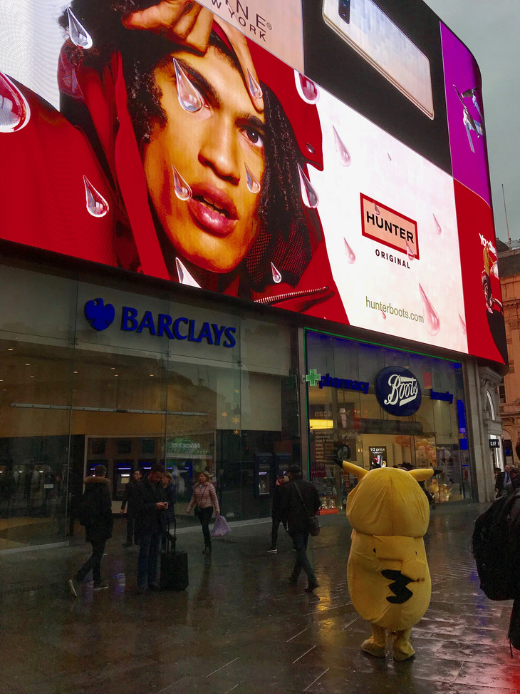 A wet Pikachu in Piccadilly Circus