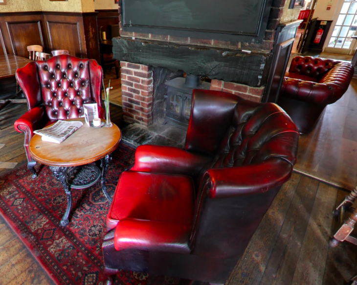 Cosy armchairs beside the fire in the Black Lion.