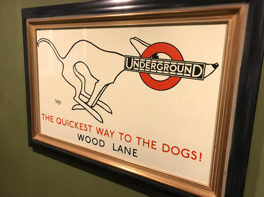 A dog with a tube roundel for a head.