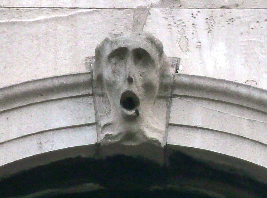 A screaming face on a church in London