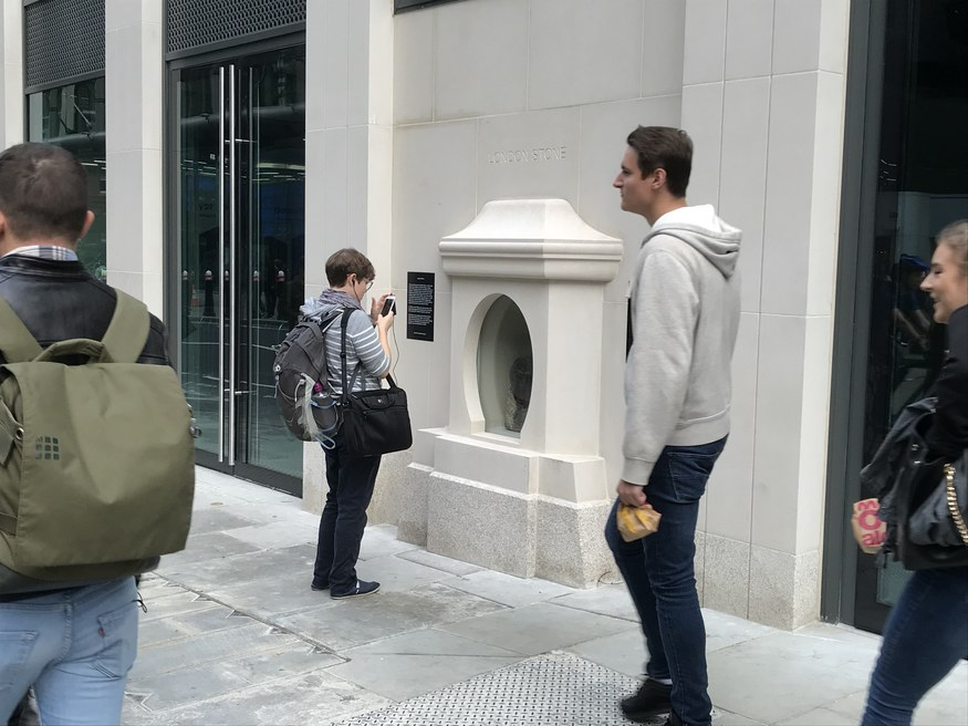 Somebody takes a photo of London Stone.